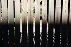 Contrast fence. High contrast wooden fence with sunshine Royalty Free Stock Photography
