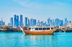 Old boats and modern buildings in Doha, Qatar Royalty Free Stock Photo