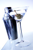 Contrast Martini. Two olive martini on underlit bar with shaker stock photo