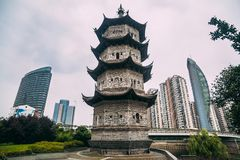 Contrast of modern buildings and historical pagoda in the city. Of Wuhu, China royalty free stock photography