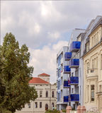 Contrast of a new building with blue balconies Royalty Free Stock Photos