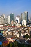 Contrast between new and holding buildings in Bangkok, Thailand. Skyline Stock Photography
