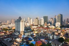 Contrast between new and holding buildings in Bangkok, Thailand. Skyline Royalty Free Stock Image