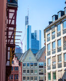 Contrast of old buildings and a skyscraper Royalty Free Stock Photo