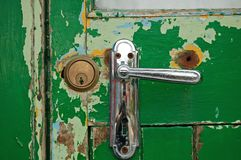 Contrast old door new lock Royalty Free Stock Photo