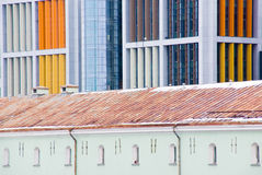 Contrast of old and new architecture. Contrast of old and modern colorful buildings Stock Photos
