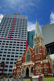 Contrast old and new Brisbane. Central Brisbane contrast difference of style of the old uniting church building against the newer business buildings royalty free stock photos