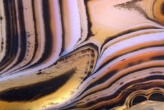 Contrast orange and brown agate structure. Background with contrast agate structure stock image