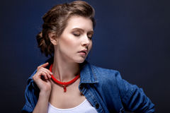 Contrast portrait of a girl on a blue background. Stock Photography