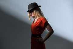 Contrast portrait of sexy blonde in a red hat Royalty Free Stock Photo