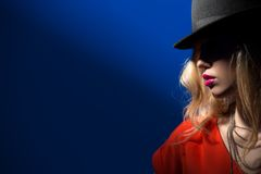 Contrast portrait of sexy blonde in a red hat Stock Photos