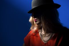 Contrast portrait of sexy blonde in a red hat Royalty Free Stock Images