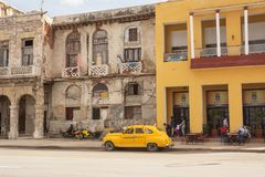 Contrast between renovated and decadent buildings on the Malecon. Havana, Cuba - December 11, 2017: Contrast between renovated and decadent buildings on the Stock Photos