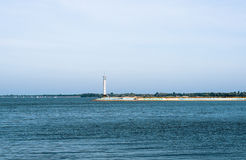 Contrast sea panorama with lighthouse on the pier Stock Images