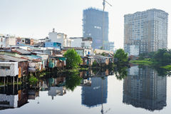 The contrast between slum houses and buildings in Ho Chi Minh city, Vietnam Royalty Free Stock Photography