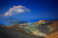 Contrast on the volcano. Alone on the top of the volcano. Vulcano island in Italy. Superb sight over the sea and the small islands Stock Photo