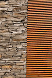 Contrast wall. Border of stone and wood wall stock images