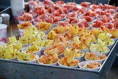Contraste de la comida dulce y picante Imagenes de archivo