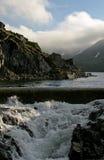Contraste entre el agua tranquila y salvaje Fotos de archivo libres de regalías