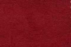 Contraste a textura macia da tela em fascinar a cor vermelha fotos de stock