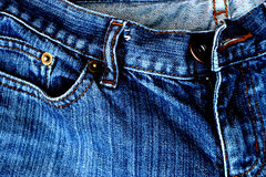 Contrasted jeans. Jeans trousers closeUp Royalty Free Stock Photography