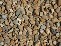 Contrasted pebbles in the sunlight stock image