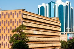 Contrasting architectural styles, Kampala, Uganda. Contrasting architectural styles, with Post Office in foreground and modern office block behind, Kampala Road Stock Images