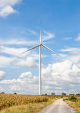 The contrasting with big standalone wind turbine and small windi Royalty Free Stock Image