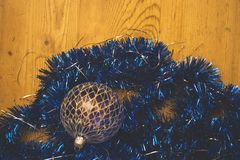 Contrasting blue Christmas decorative chains and blue glass ball Stock Image