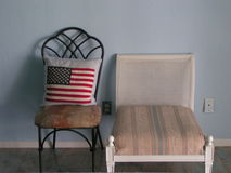 Contrasting Chairs. Two contrasting chairs in a bedroom Royalty Free Stock Images