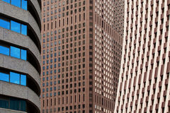 Contrasting city office blocks. Three different office block styles close together stock image