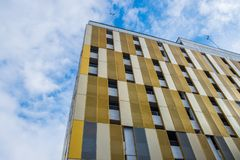 Free Contrasting Colors And Shapes On Building Facade Against The Sky Stock Image - 129381451