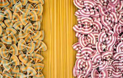 Contrasting coloured abstract pasta backgrounds Stock Photo