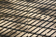 Contrasting picture. Paving slabs on a sunny day. The light and shadow. Royalty Free Stock Image