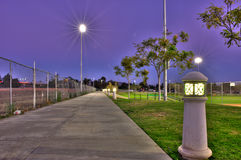 Contrasting sides under the park lights Royalty Free Stock Photos