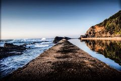 Contrasting waters. Ocean tidal pool calm turbulent scenic travel royalty free stock photo