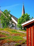 Contrasts. Church small building. Royalty Free Stock Photography