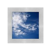 Contrasty Sky. A contrasty blue cloudy sky photographed during the day Stock Image