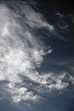 Contrasty Sky. A contrasty blue cloudy sky photographed during the day Stock Images