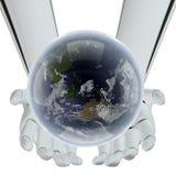 Contrat à terme de la terre dans des mains de la technologie Photos stock