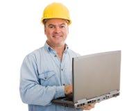 Contratista con la computadora portátil Fotografía de archivo libre de regalías
