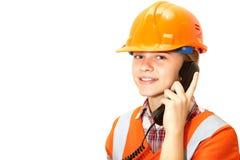 Contratista joven en el teléfono en la oficina Fotos de archivo