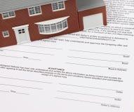 Contrato de la casa Imágenes de archivo libres de regalías