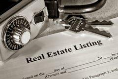 Contrato de lista e caixa do fechamento dos bens imobiliários Foto de Stock