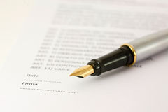 Contratto. Contract and pen to underscribe royalty free stock photos