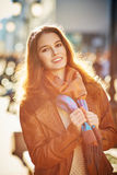 Contre-jour outdoor portrait of beautiful redhead woman Royalty Free Stock Images