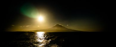 Contre jour view to Sunrise over Pico volcano and island, Azores, Portugal Stock Photography