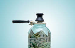 The contribution of currency. In a glass jar Stock Photography