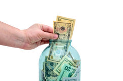 The contribution of currency in a glass jar Stock Photo