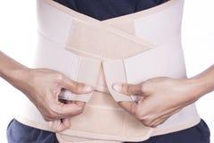 Contributo della parte posteriore del primo piano alla parte posteriore del muscolo Fotografia Stock Libera da Diritti